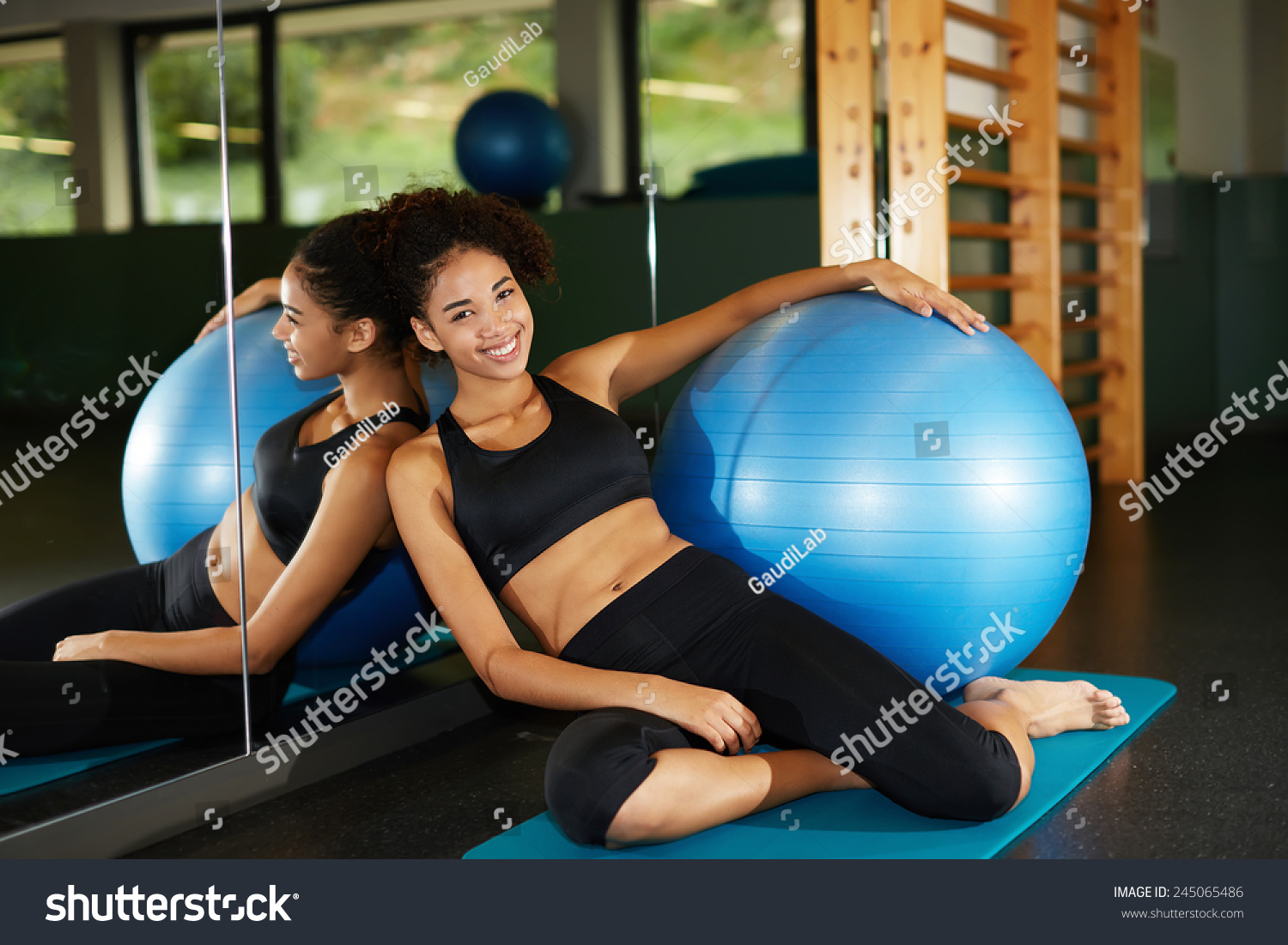 Attractive Fit Girl Relaxing After Fitness Stock Photo (Edit Now