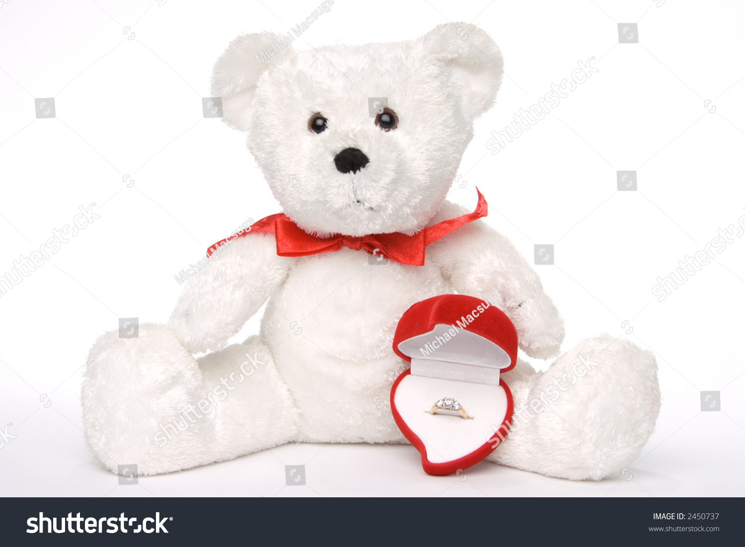 white teddy bears with hearts