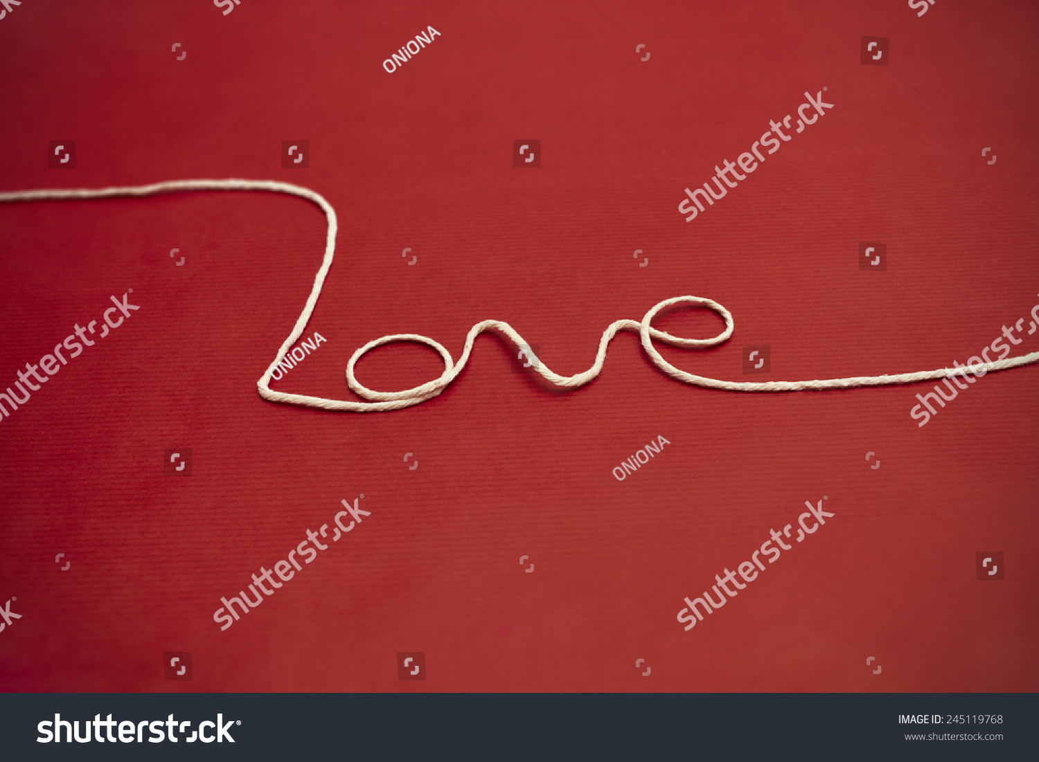 Love Word Made Of White Twine On Red Background For Your Valentine Or Mom