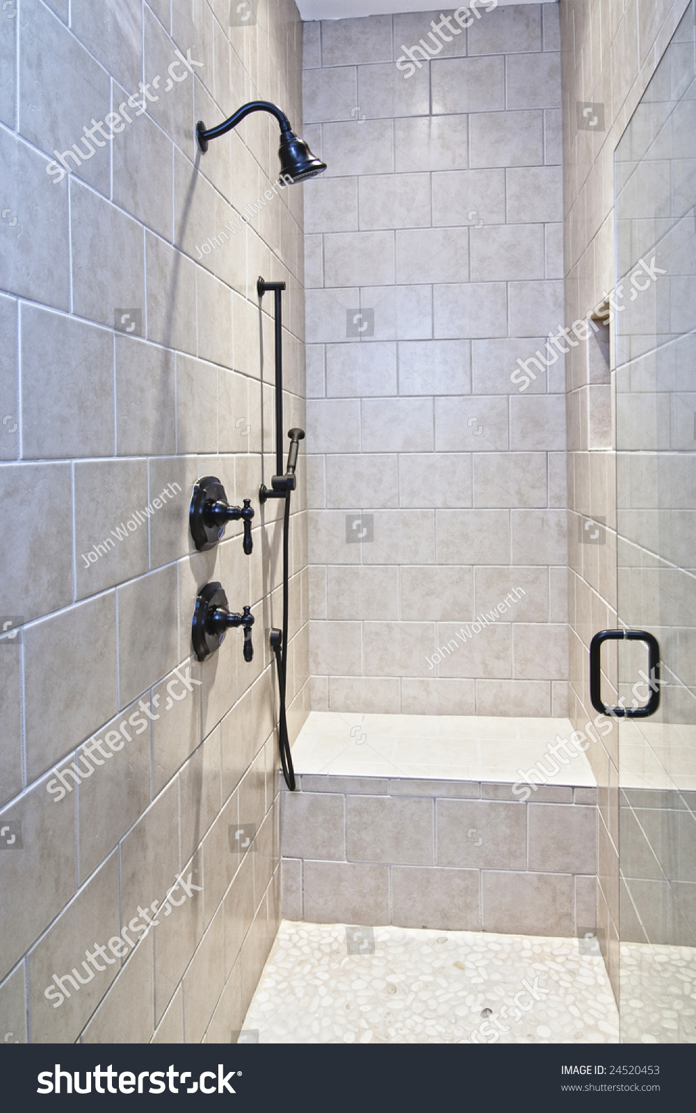 large luxury tile shower with pebble stone floor - Luxury Stone Showers