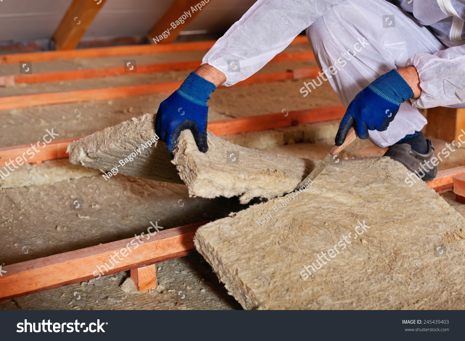 Installing thermal insulation layer closeup on stock photo for Mineral wool installation