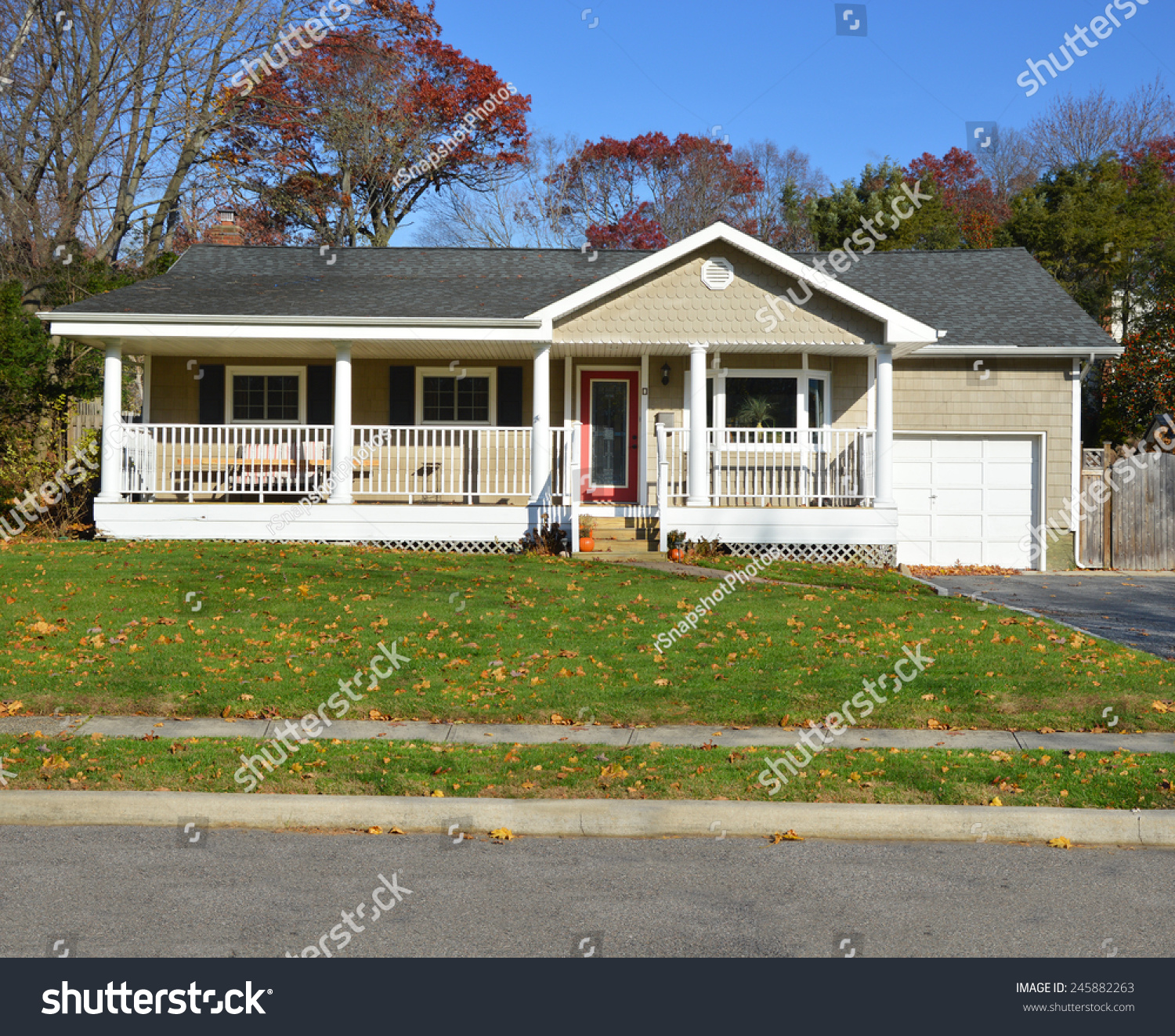 Suburban ranch style home porch sunny stock photo for Ranch home with porch