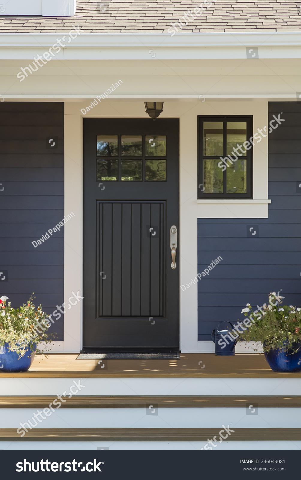 Closed Black Front Door With White Surrounding Door Frame