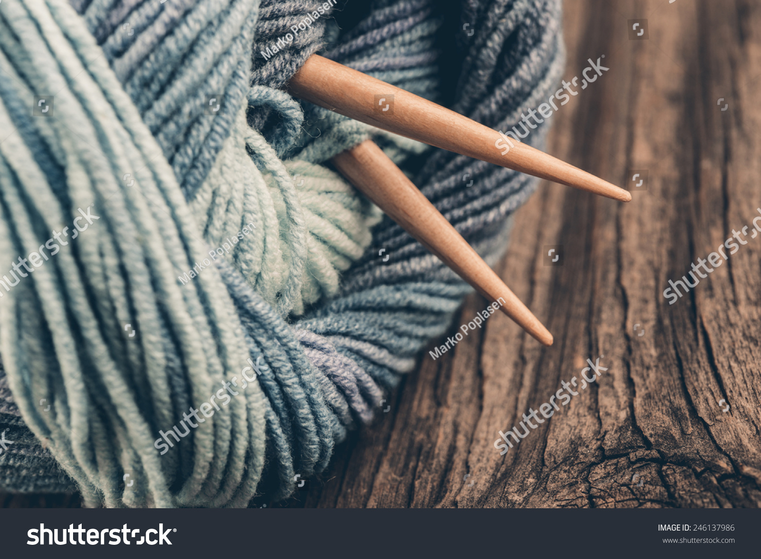 knitting needles and yarn on wooden backgroundnatural