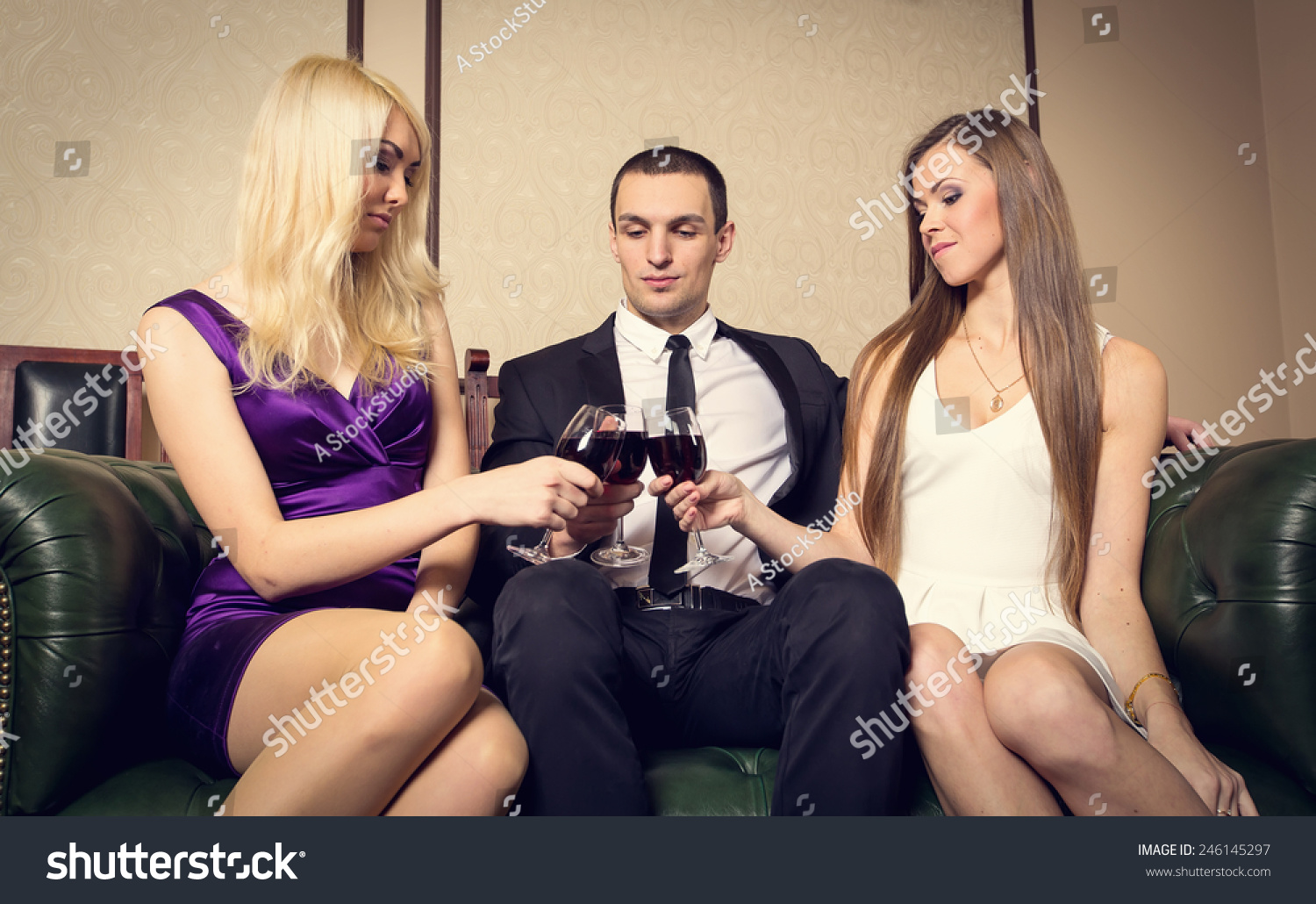 Man In Bed With Two Women royalty free stock photo WMAR