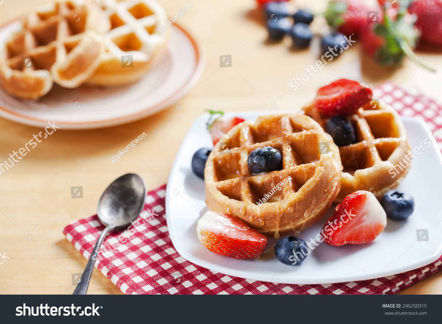 Waffles With Strawberry , Blueberry And Caramel Sauce Stock Photo ...