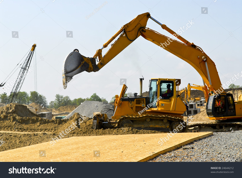 yellow bulldozer machines digging moving earth stock photo