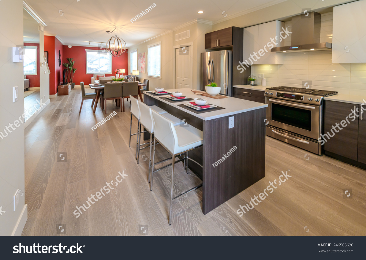 Nicely decorated kitchen counter table iceland table and dining table and living room at the