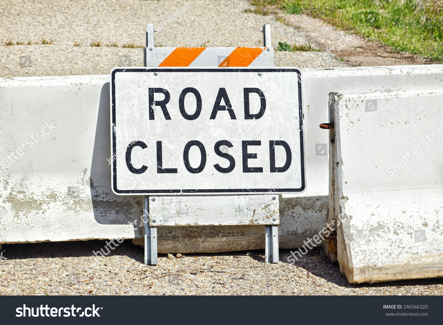 Road sign concrete barriers used show stock photo