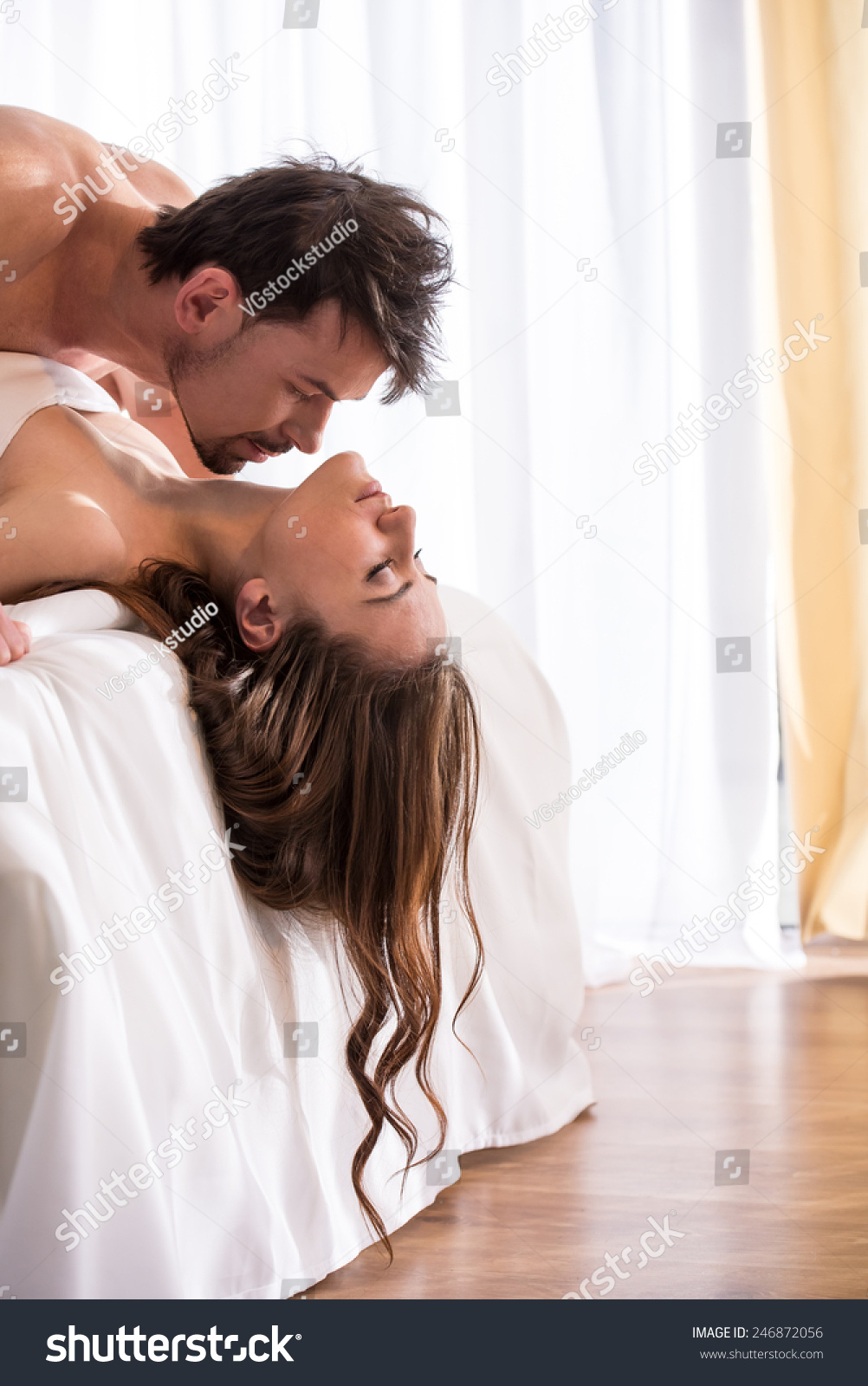 Young love couple in bed  romantic scene in bedroom. Young Love Couple Bed Romantic Scene Stock Photo 246872056