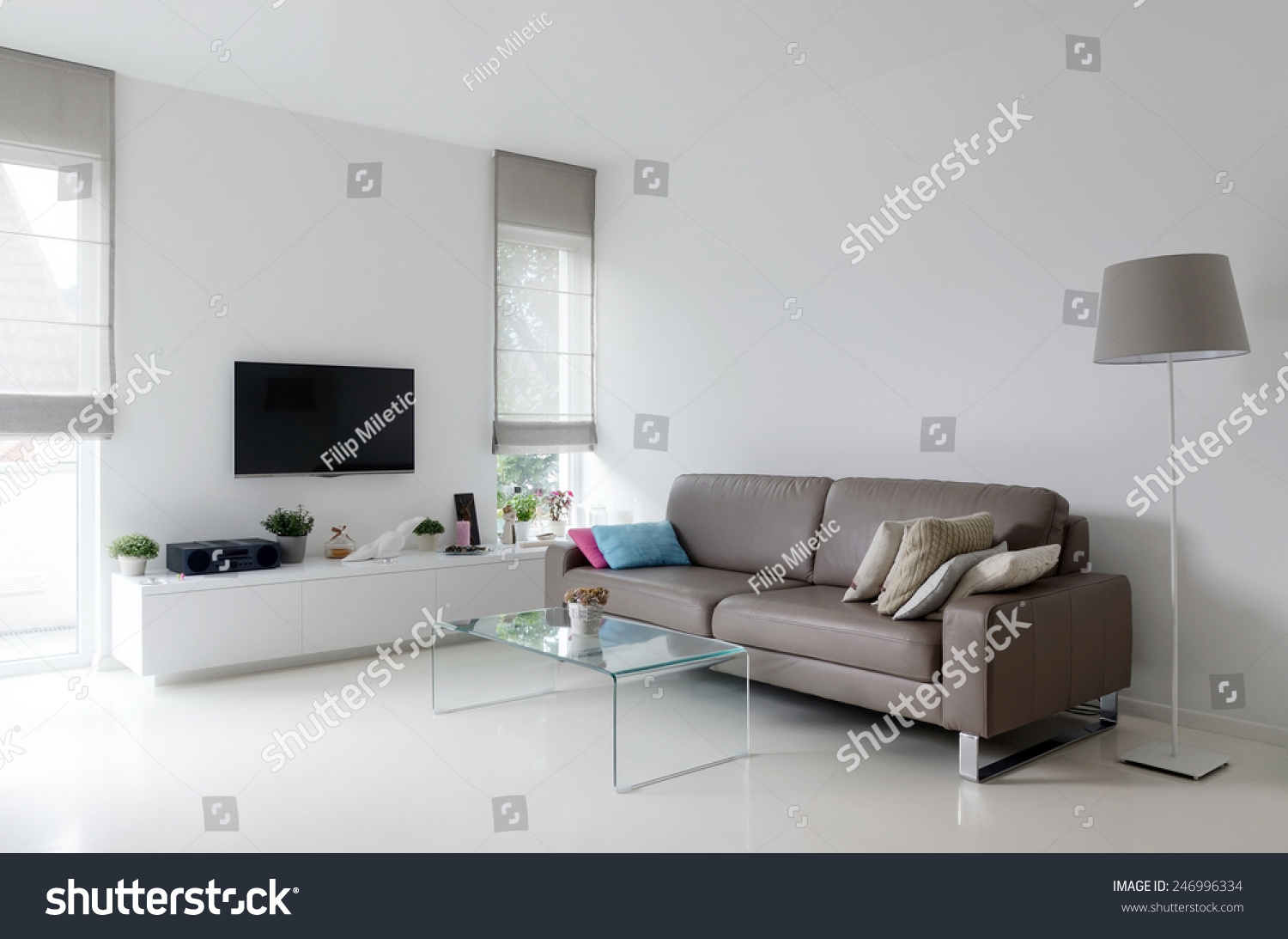 White living room taupe leather sofa stock photo 246996334