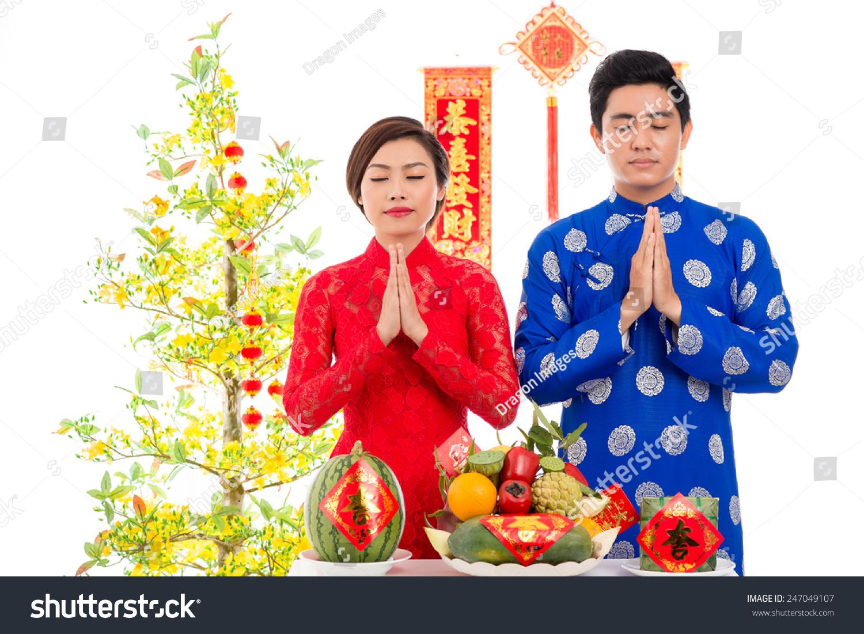 Portrait couple praying before vietnamese new stock photo edit now portrait of couple praying before vietnamese new year celebration m4hsunfo