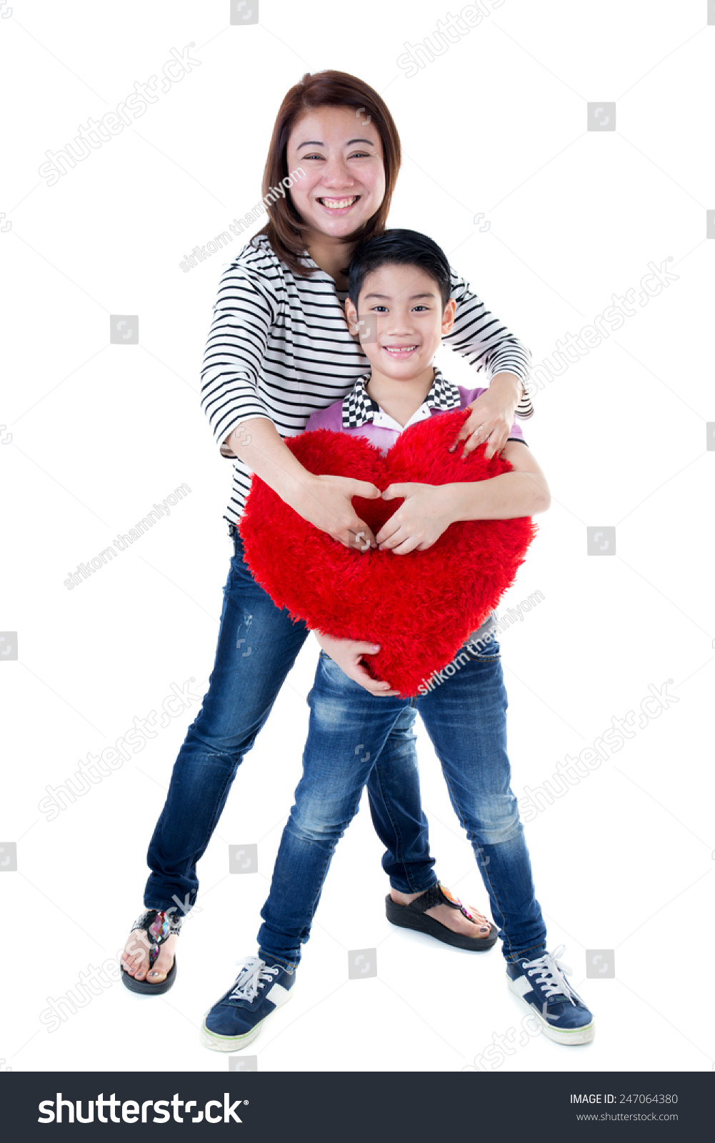 Happy asian mom and son hold big red heart on white background