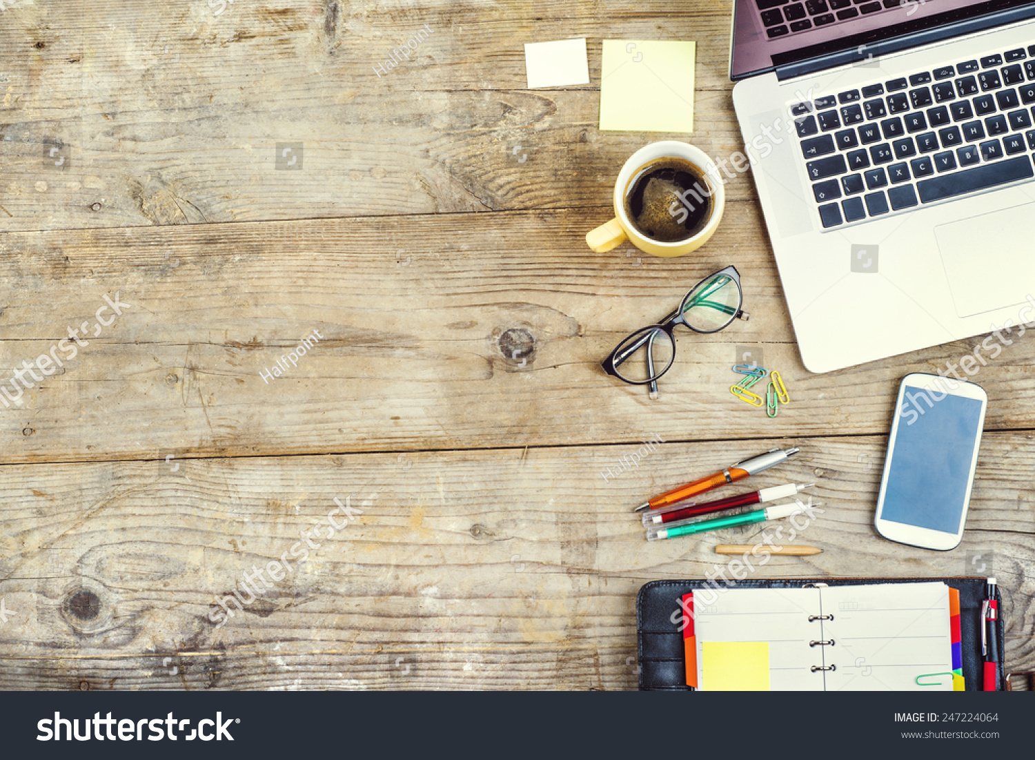 Mix office supplies gadgets on wooden stock photo for Best home wallpaper websites