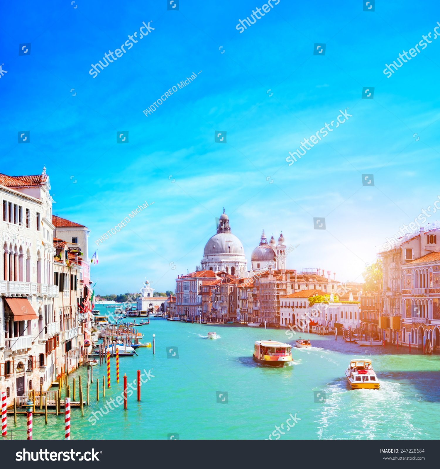Venice, Italy. Grand Canal and the Salute at sunny day. Tourist boats View from Ponte dell Accademia #247228684