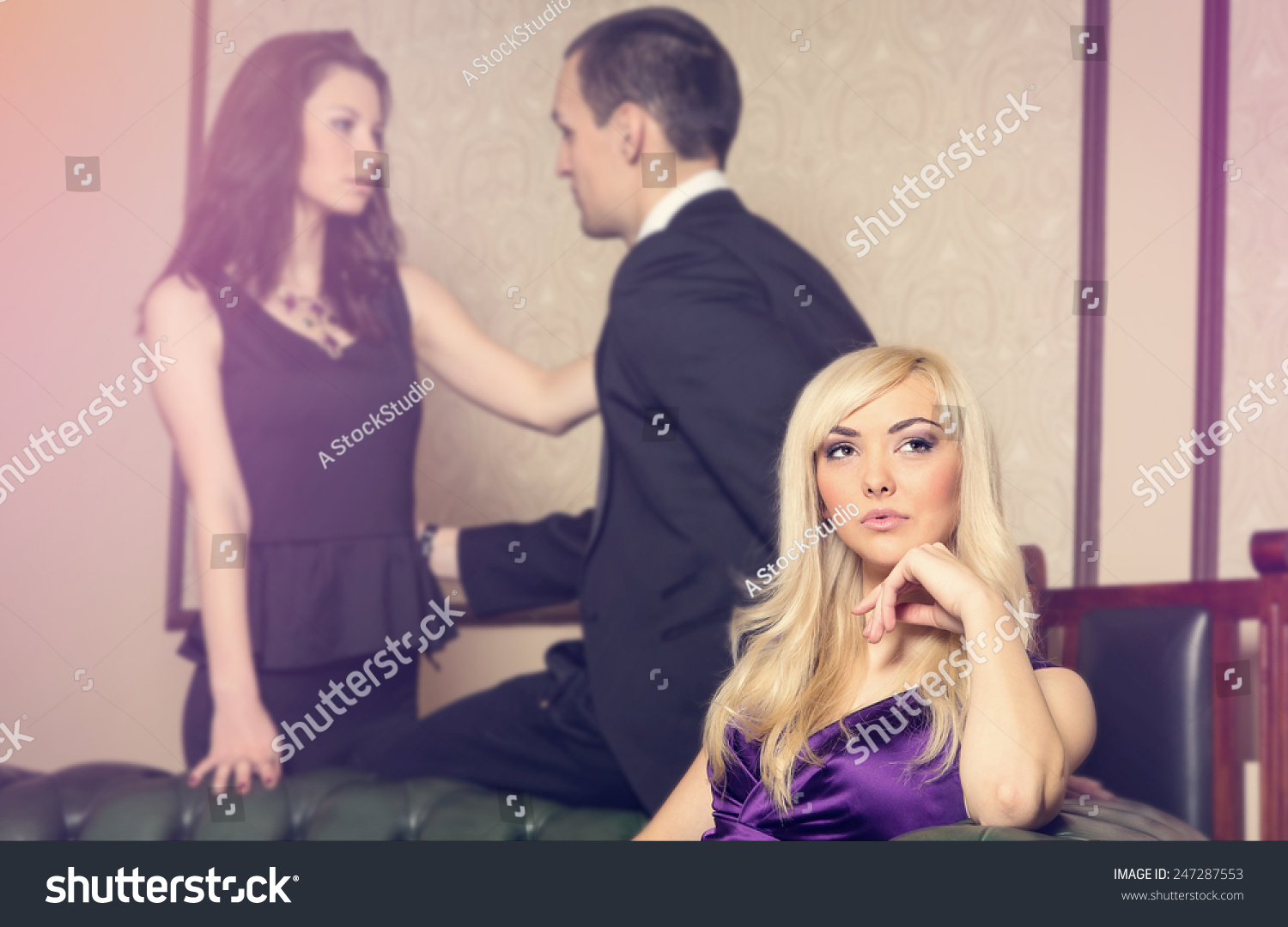 two women and a man in relationship