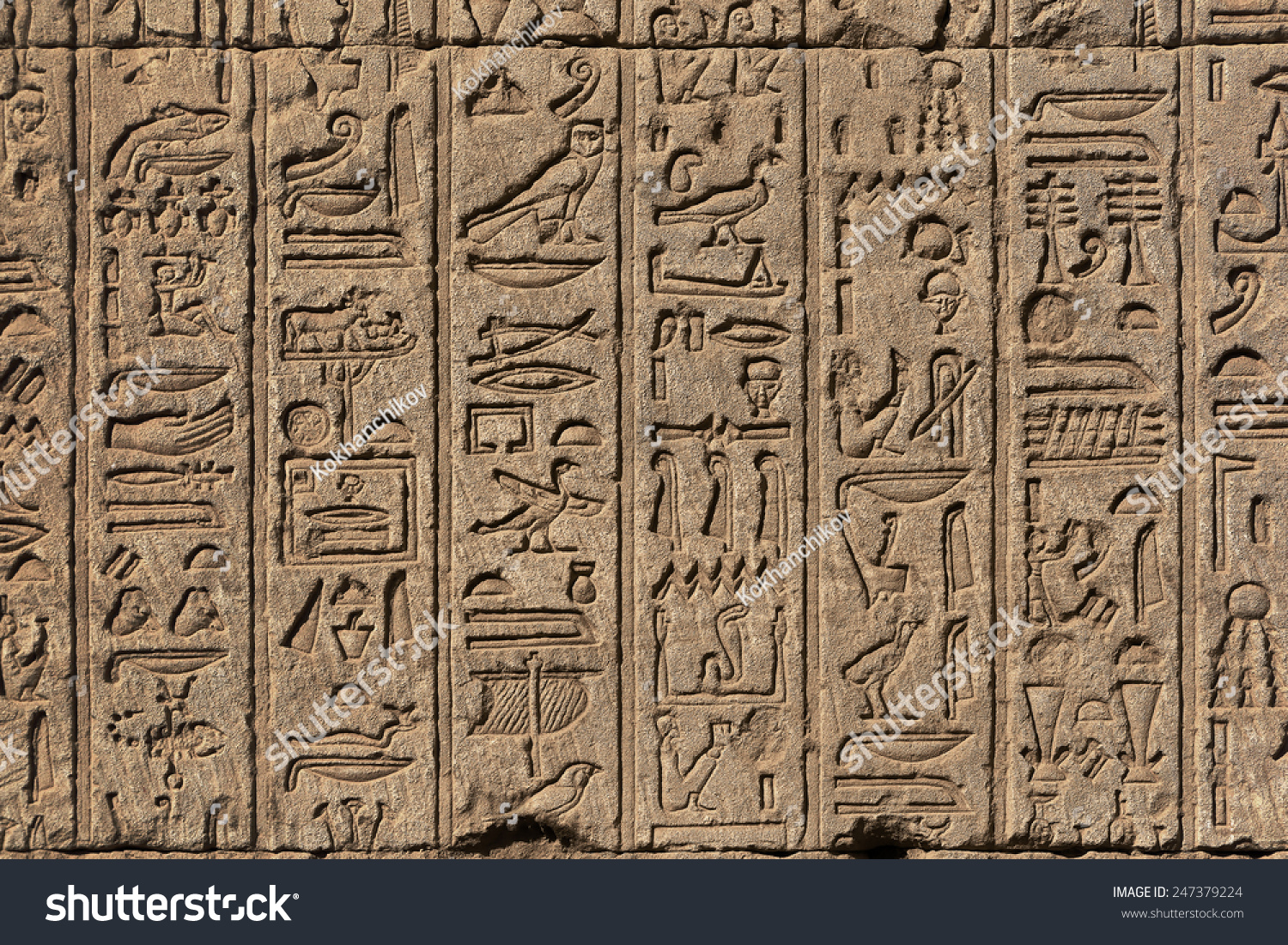 Hieroglyphic carvings on exterior walls ancient stock