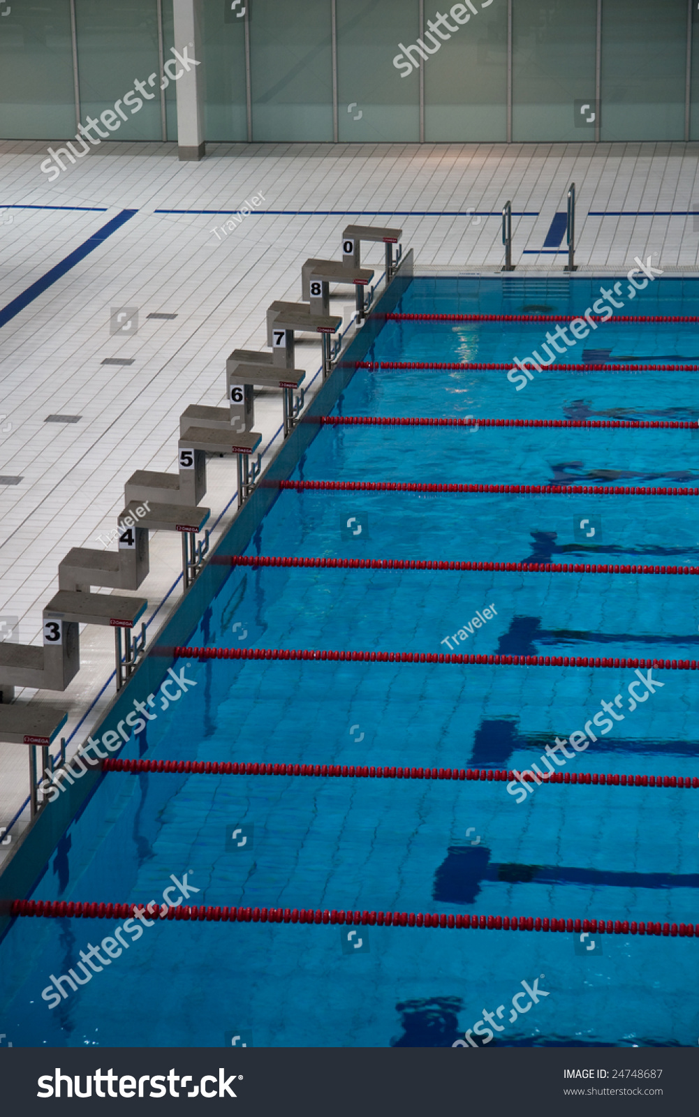The row of starting blocks of a swimming pool olympic - What is the size of an olympic swimming pool ...