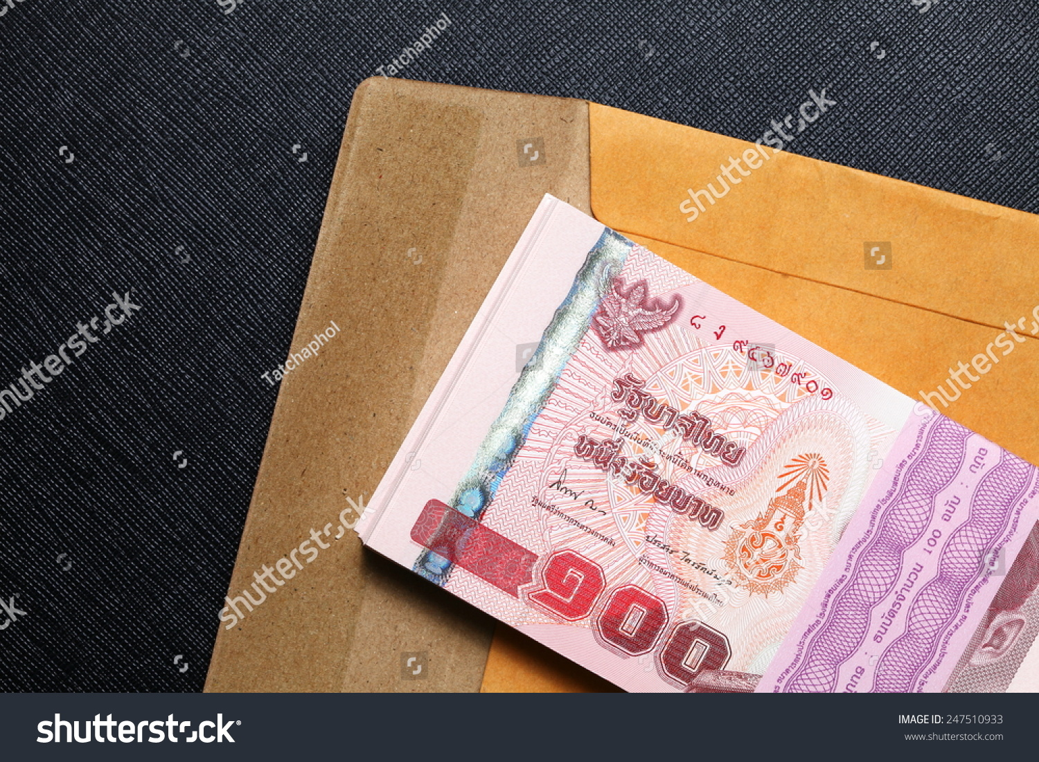 thailand one hundred baht banknotes put on the brown color paper