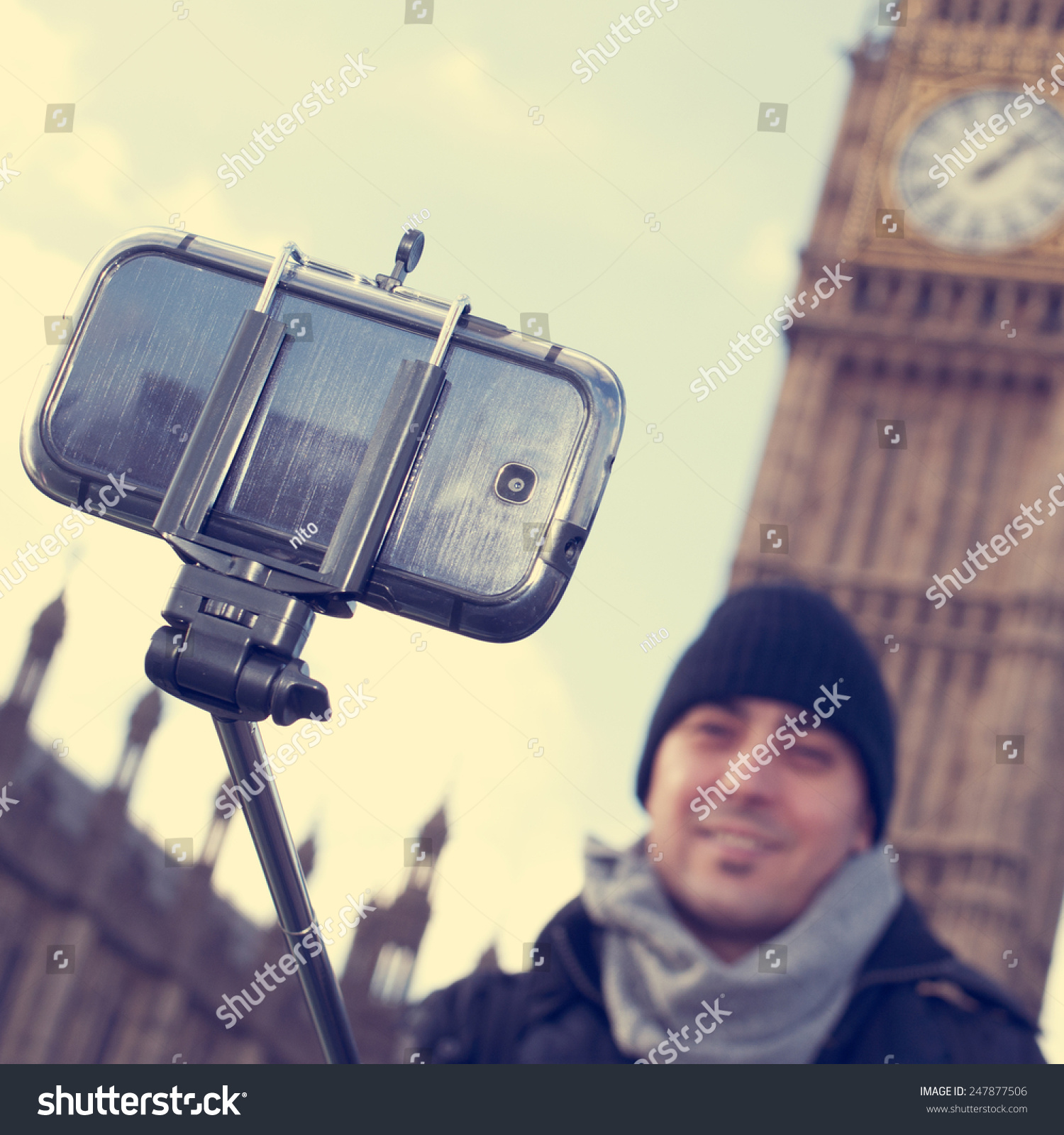 man taking a self portrait with a selfie stick in front of the big ben in london united kingdom. Black Bedroom Furniture Sets. Home Design Ideas