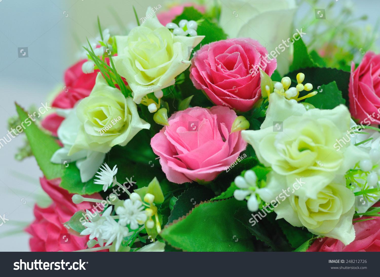 Beautiful flowers basket on table stock photo 248212726 shutterstock beautiful flowers in basket on table izmirmasajfo