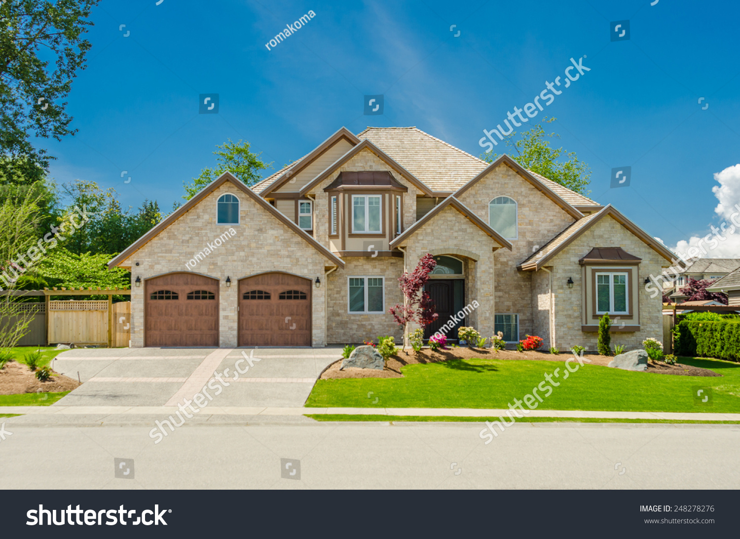 Big luxury custom made house with nicely landscaped front for Garage in front of house
