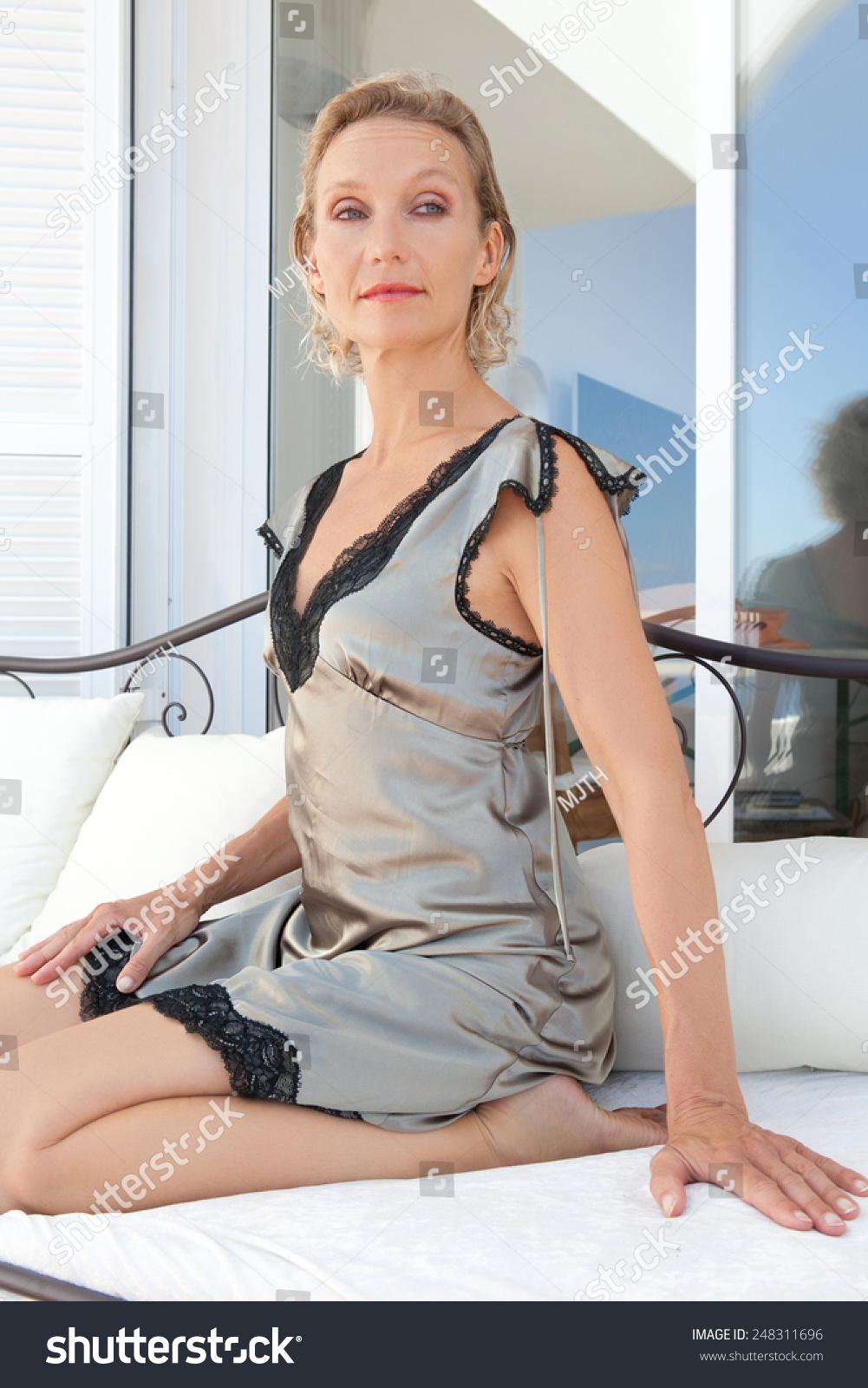 portrait beautiful mature senior woman kneeling stock photo (royalty