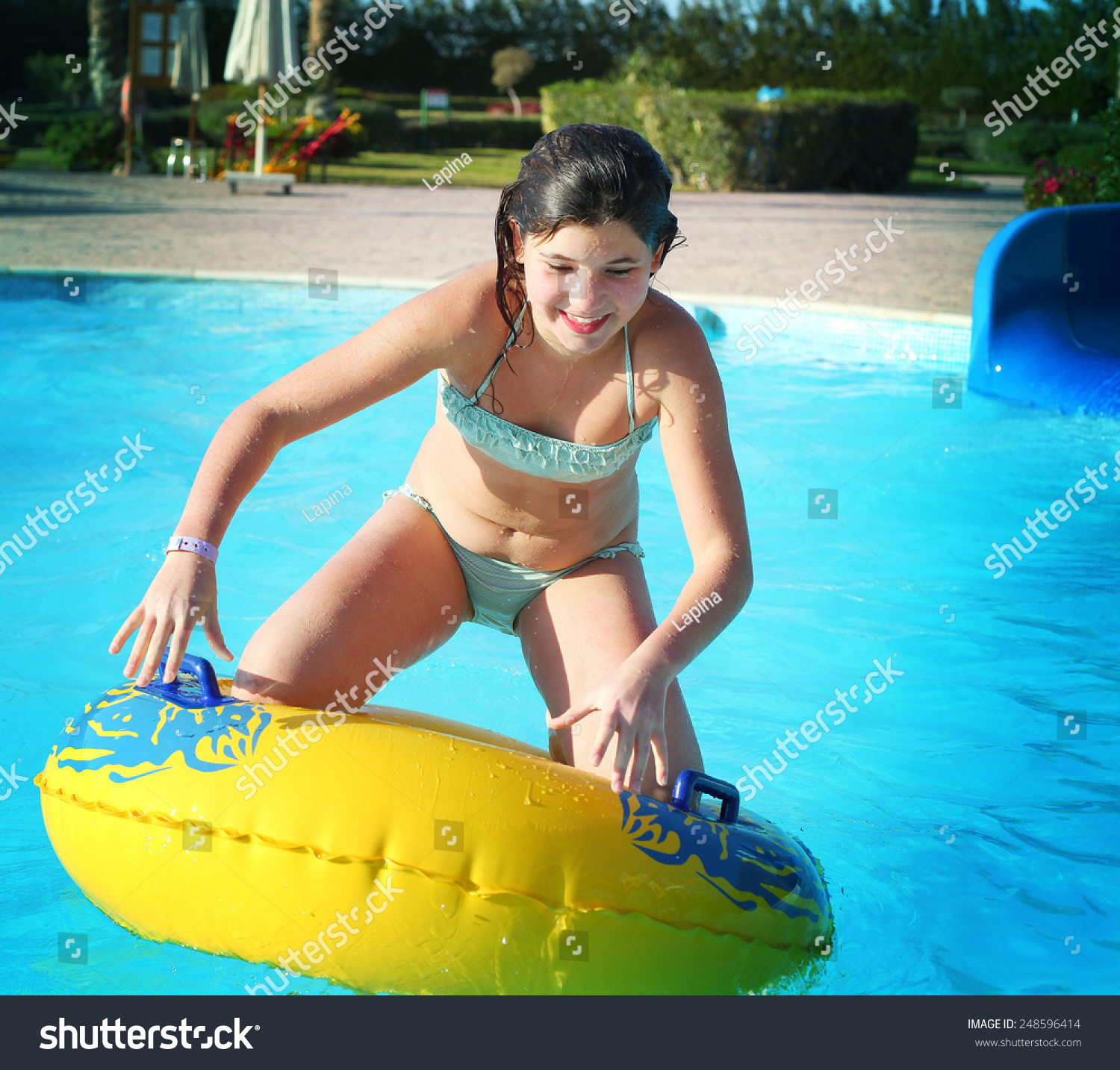 preteen beautiful girl water slide open stock photo (royalty free