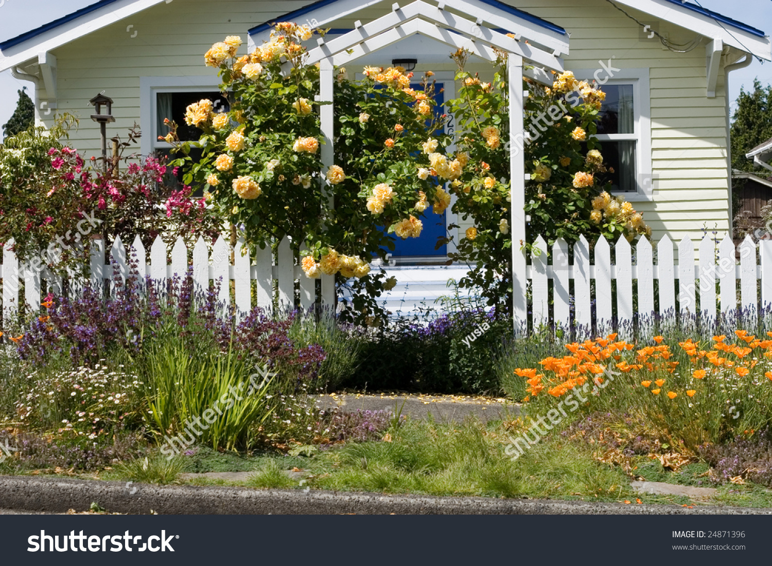 House with bright flowers in the front yard stock photo - Flowers in the front yard ...