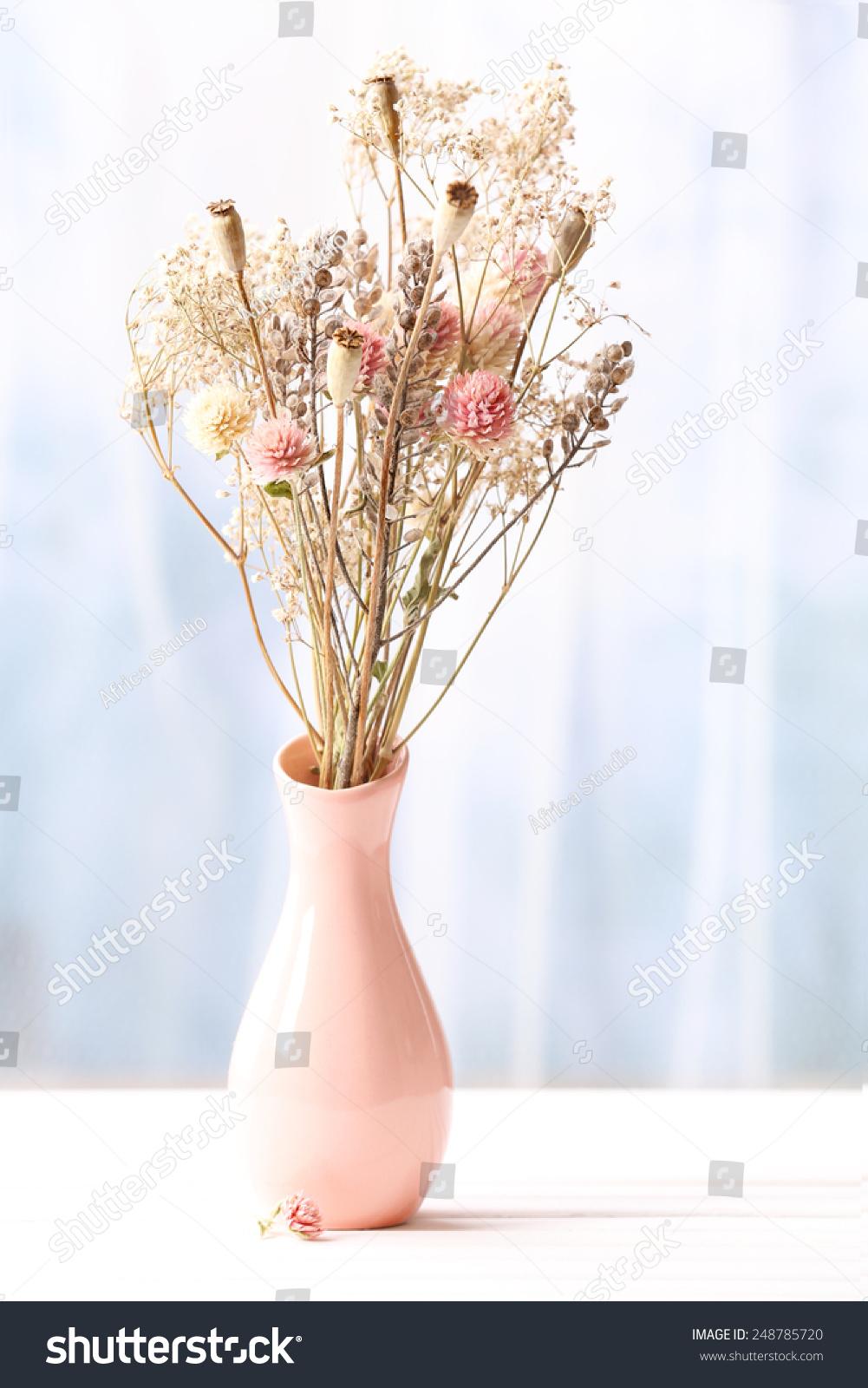 Bouquet dried flowers vase on light stock photo edit now 248785720 bouquet of dried flowers in vase on light background izmirmasajfo