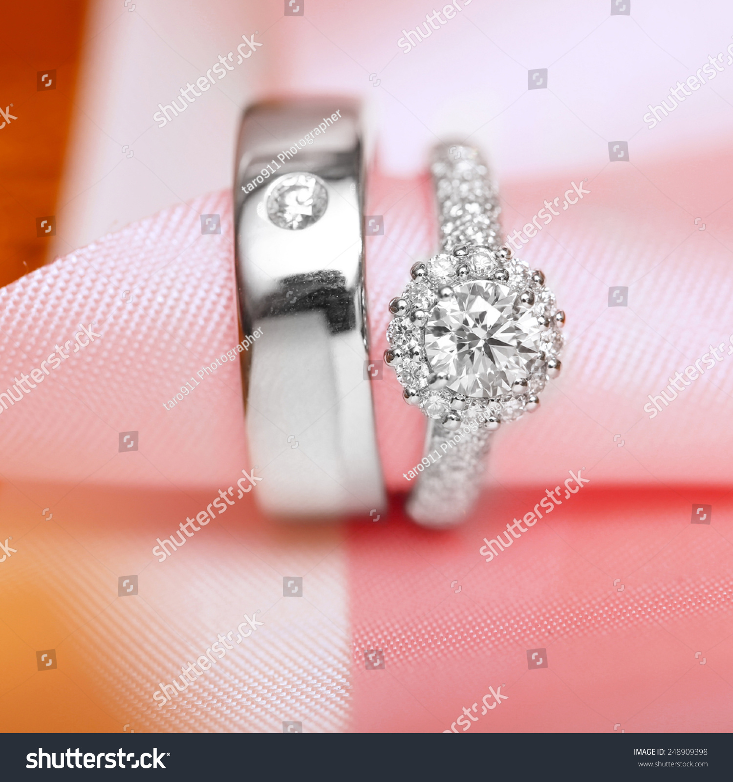 Diamond Couple Wedding Rings On Pink Stock Photo (Download Now ...