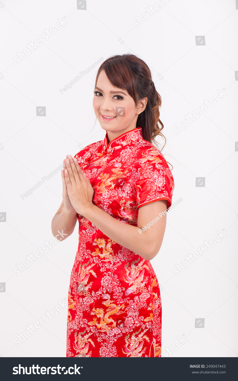 Asian girl greeting in traditional chinese welcome guest put the id 249047443 m4hsunfo