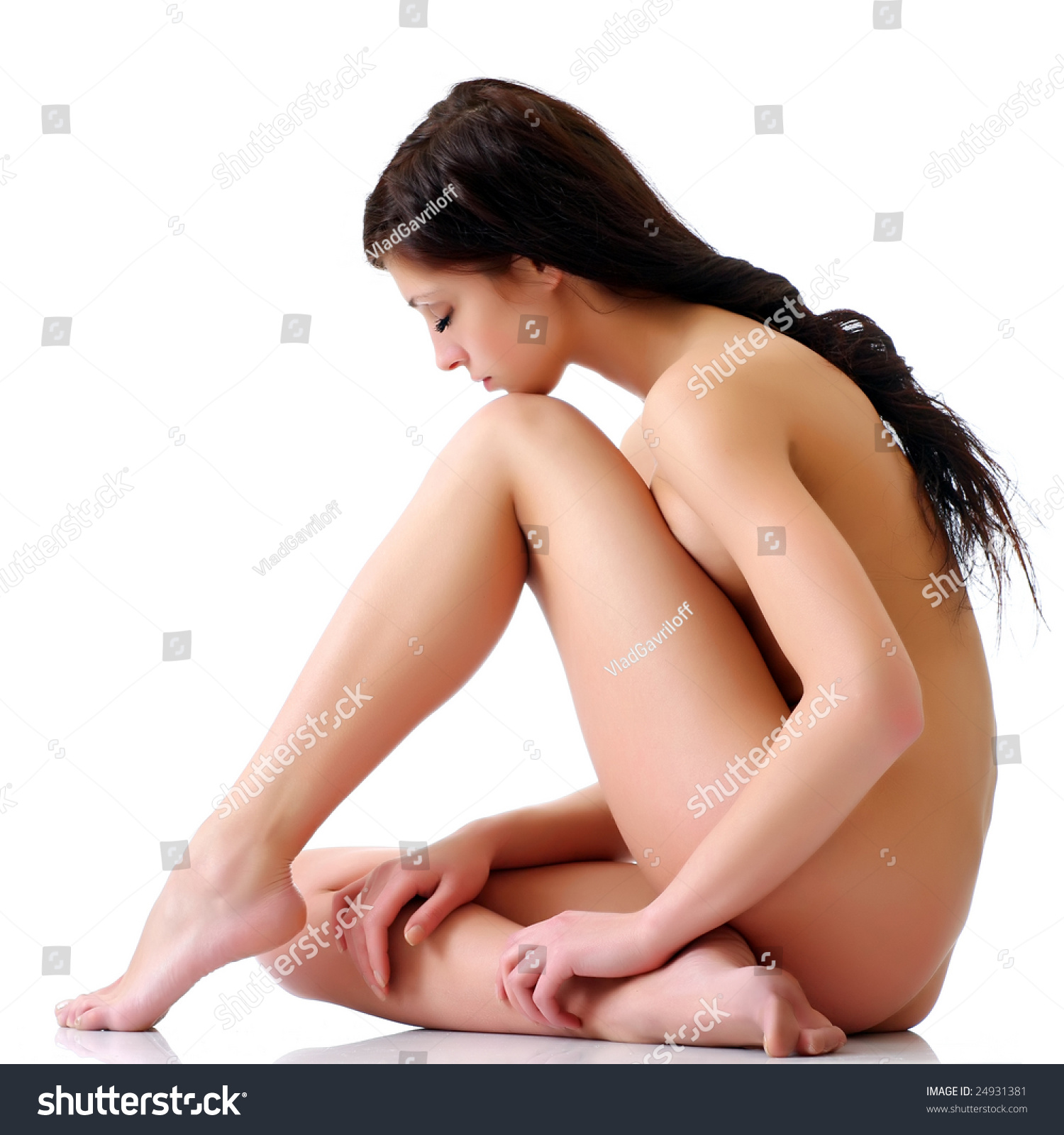 naked brunette girl lowered head on stock photo (royalty free
