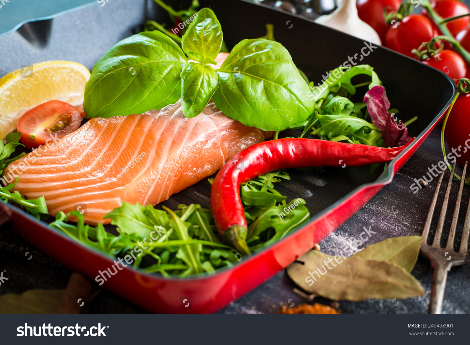 Raw red fish vegetables stock photo 249498901 shutterstock for Fish with vegetables