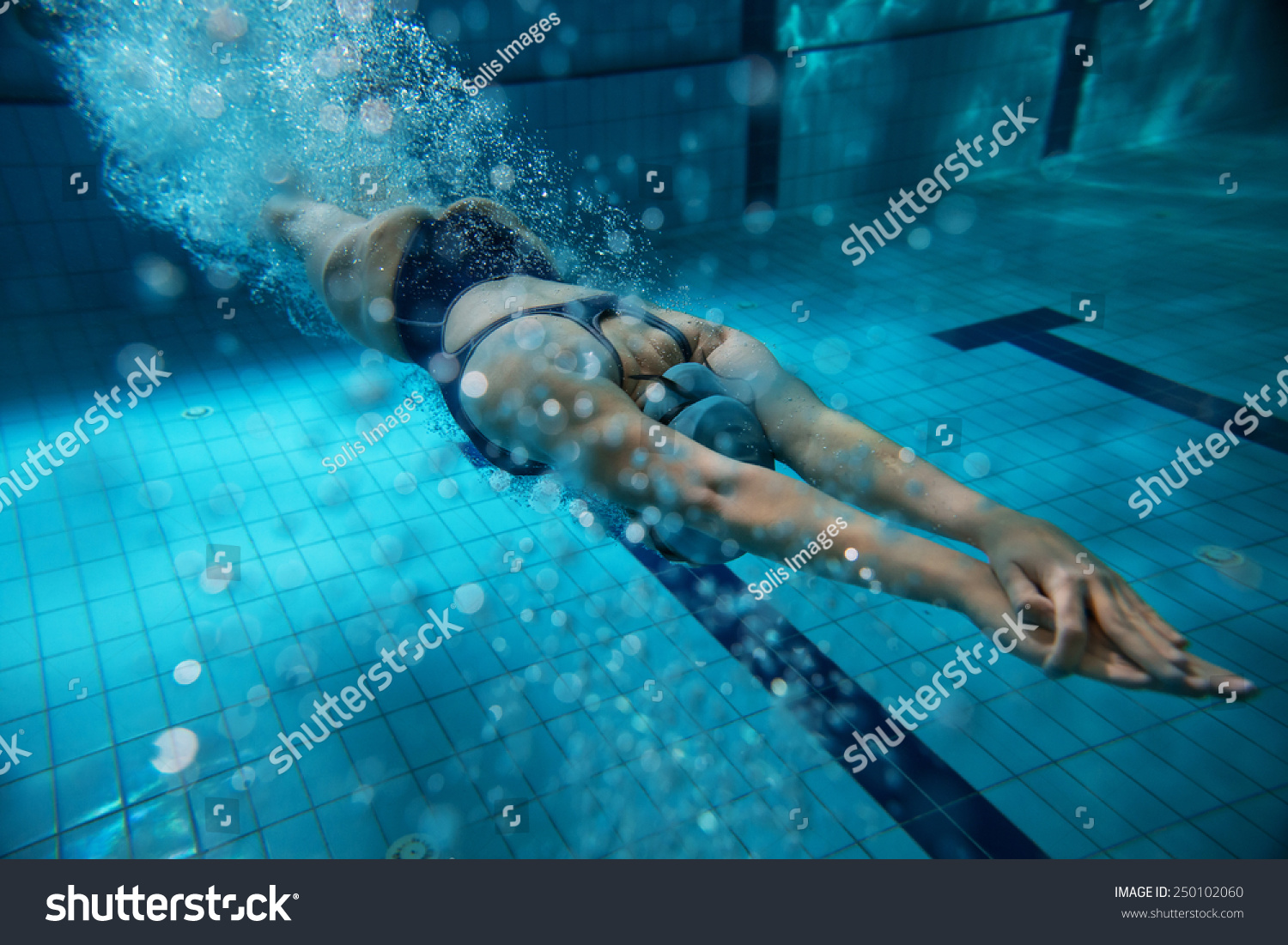 Female Swimmer At The Swimming Pool Underwater Photo