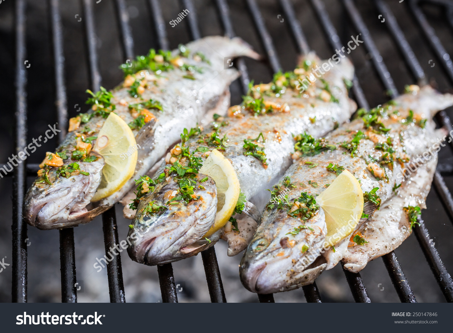 Grilled fish with lemon and spices stock photo 250147846 for Grilled fish seasoning