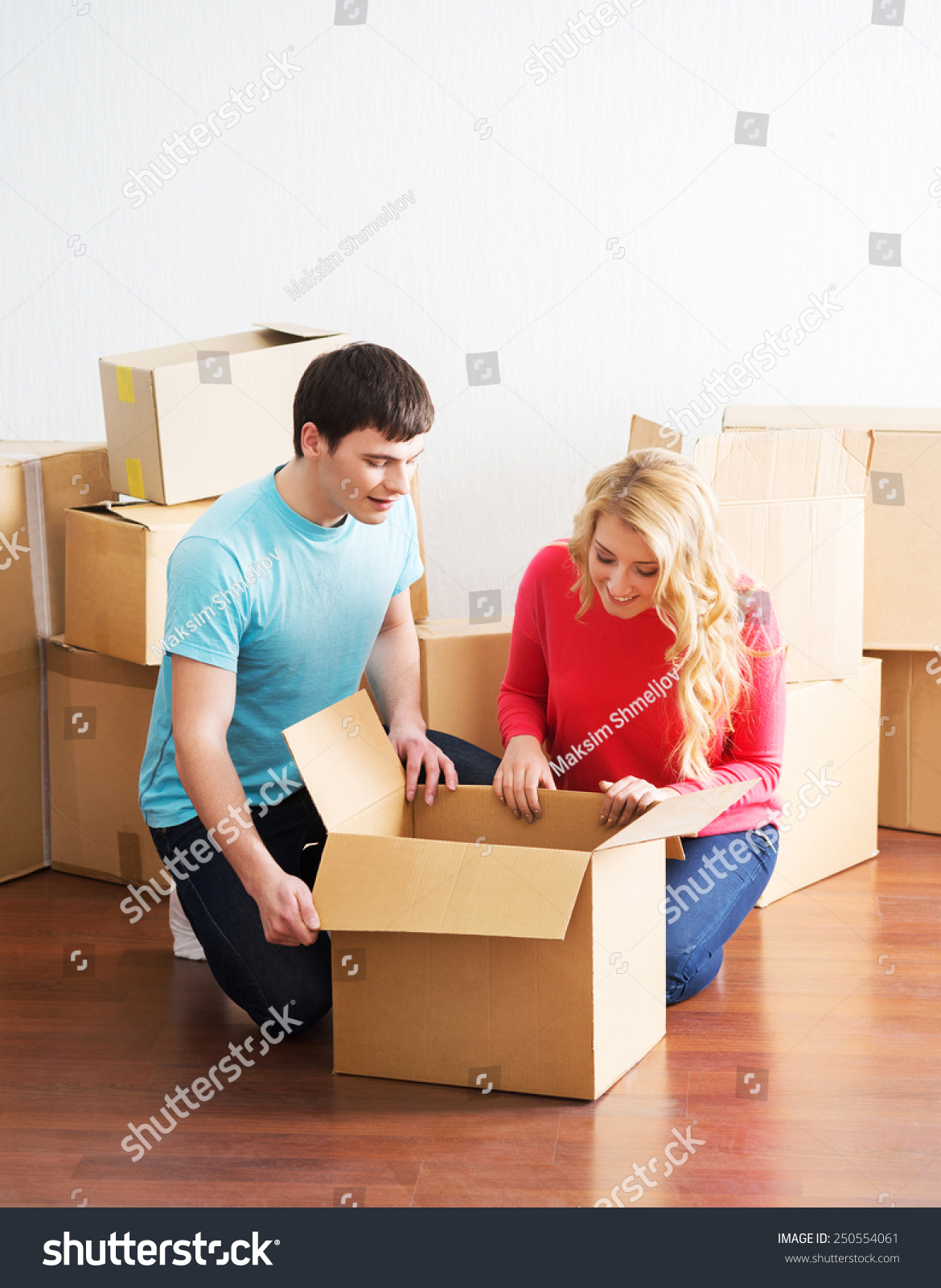 Young couple moving new home man stock photo 250554061 shutterstock - Young couple modern homes ...