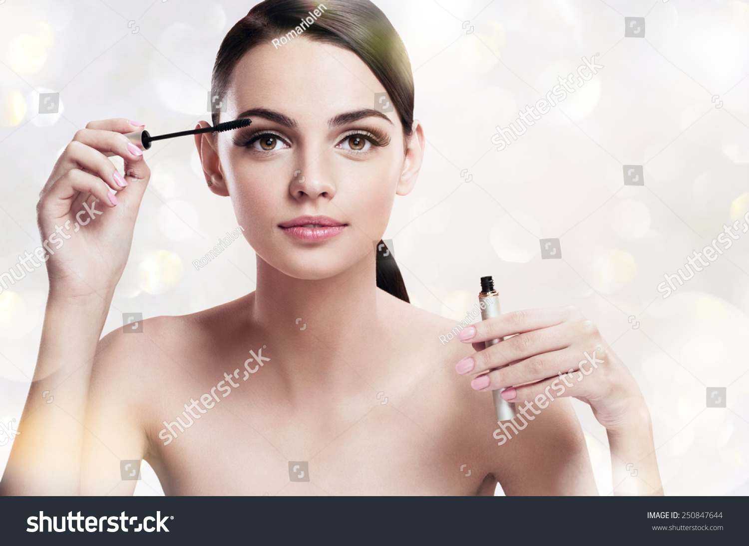 Charming young woman applying mascara photoset of attractive brunette girl on blurred - Charming teenage girls image ...