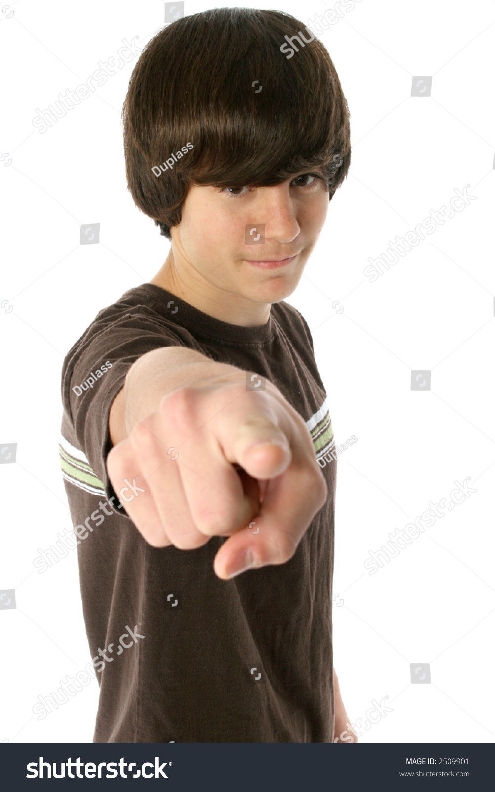 Cute 13 Year Old Boy Pointing Finger. White Background