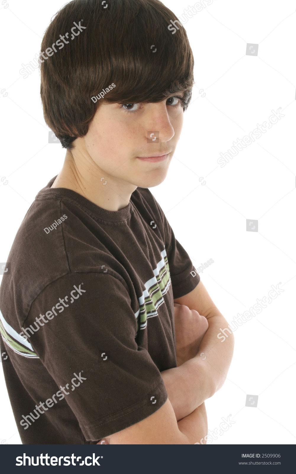 Cute 13 Year Old Boy With Arms Crossed. White Background
