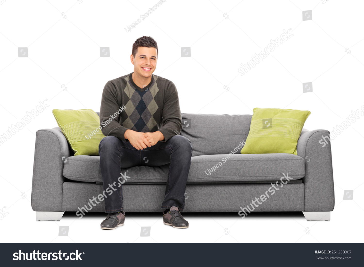 Royalty-free Cheerful young man sitting on a modern… #251250307 ...
