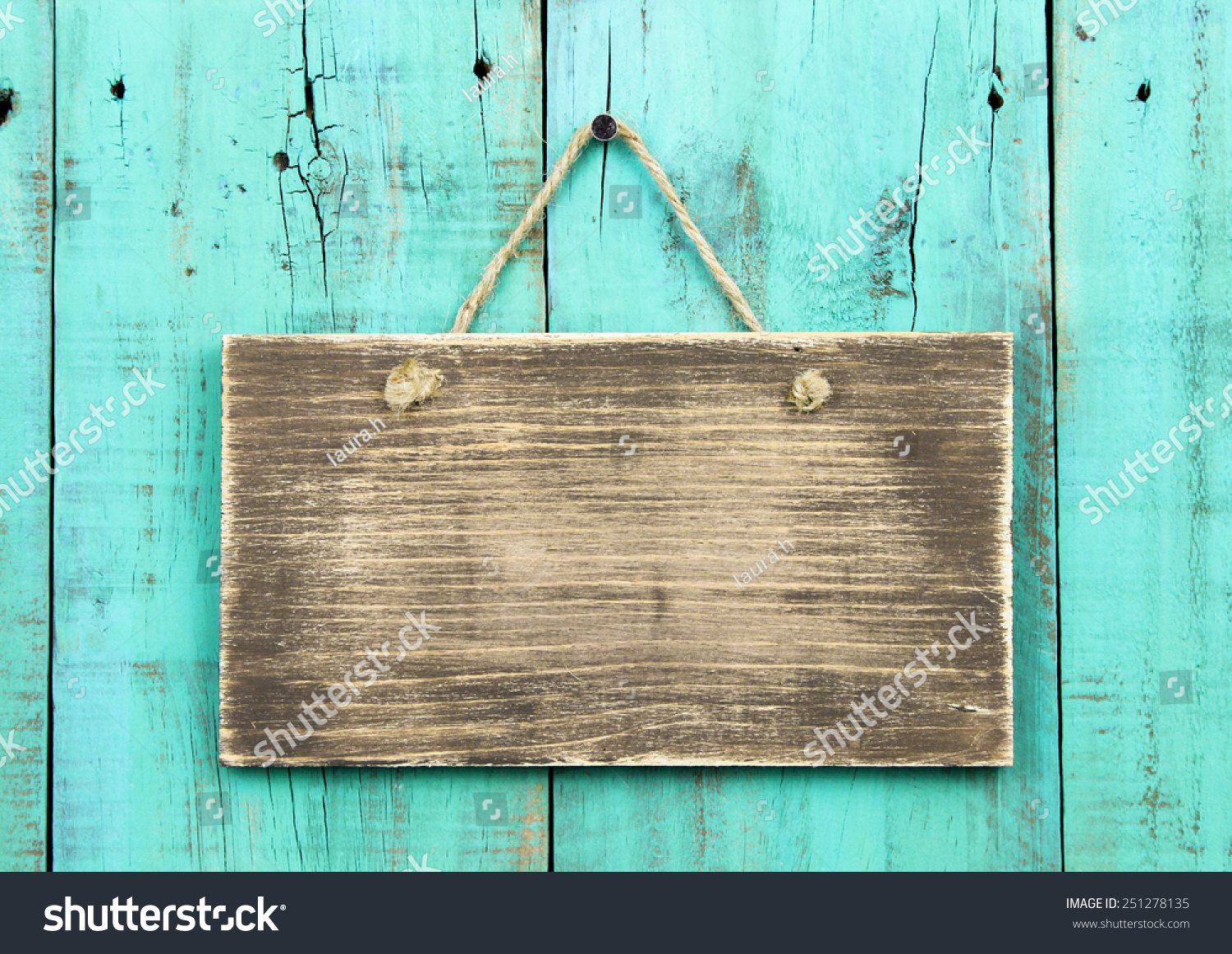 Blank Rustic Wooden Sign Hanging On Washed Out Teal Blue
