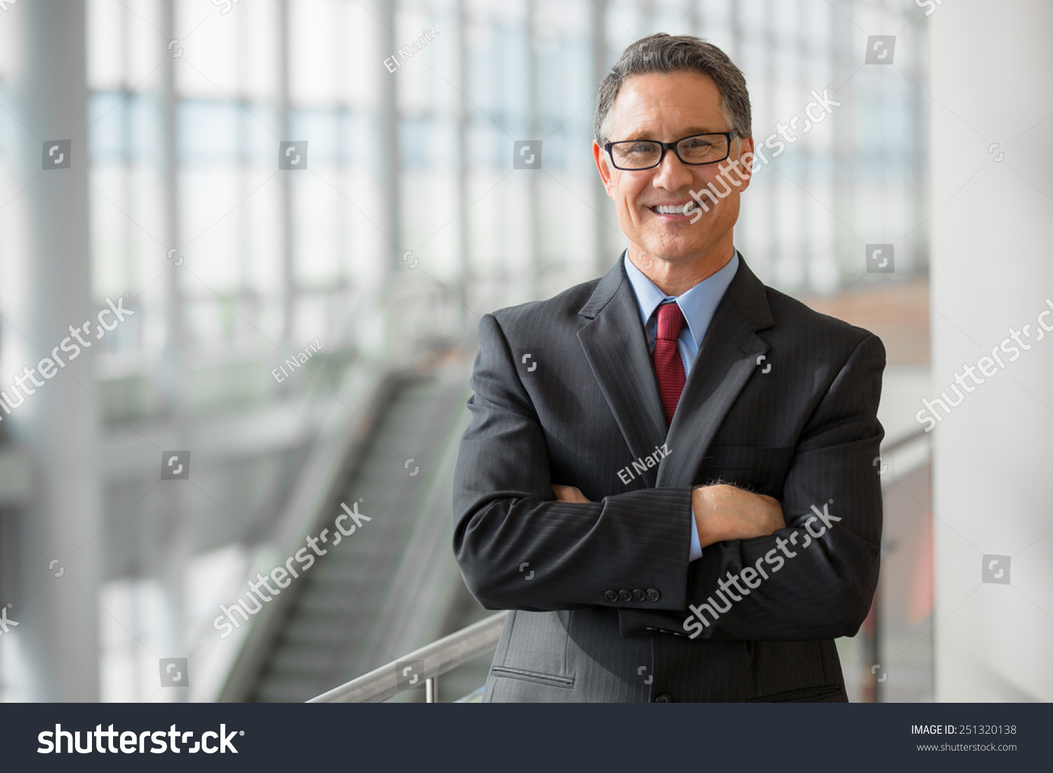 Portrait of a handsome CEO smiling  #251320138