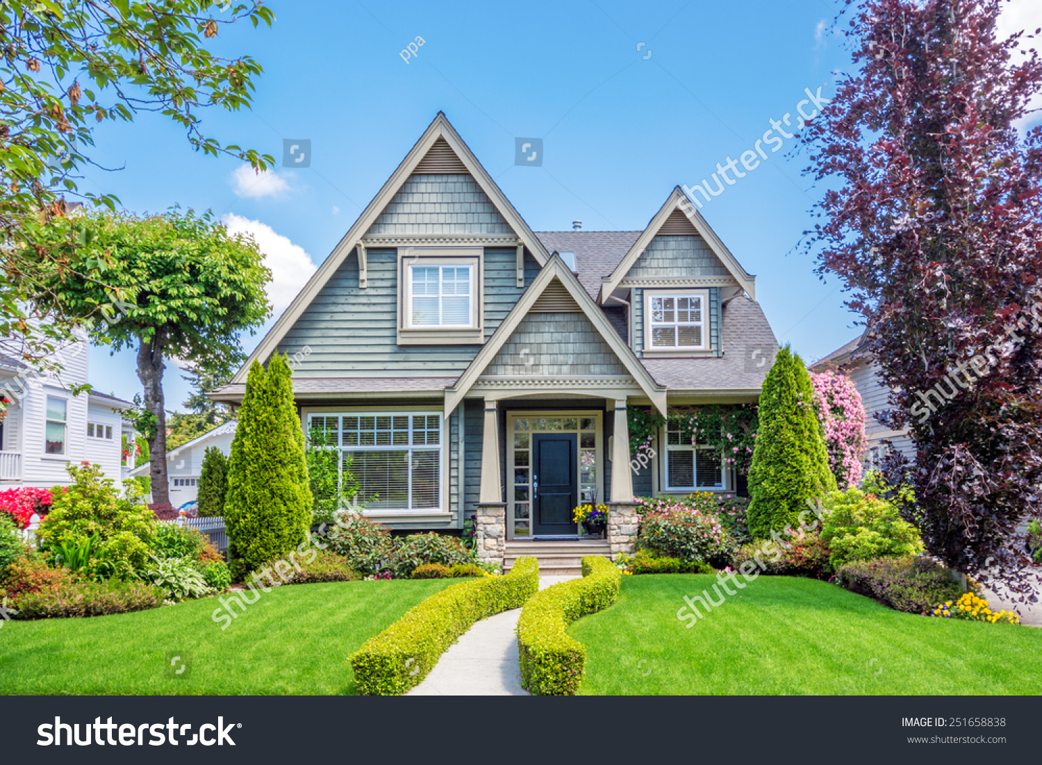 Cozy house with beautiful landscaping on a sunny day home for Cozy homes