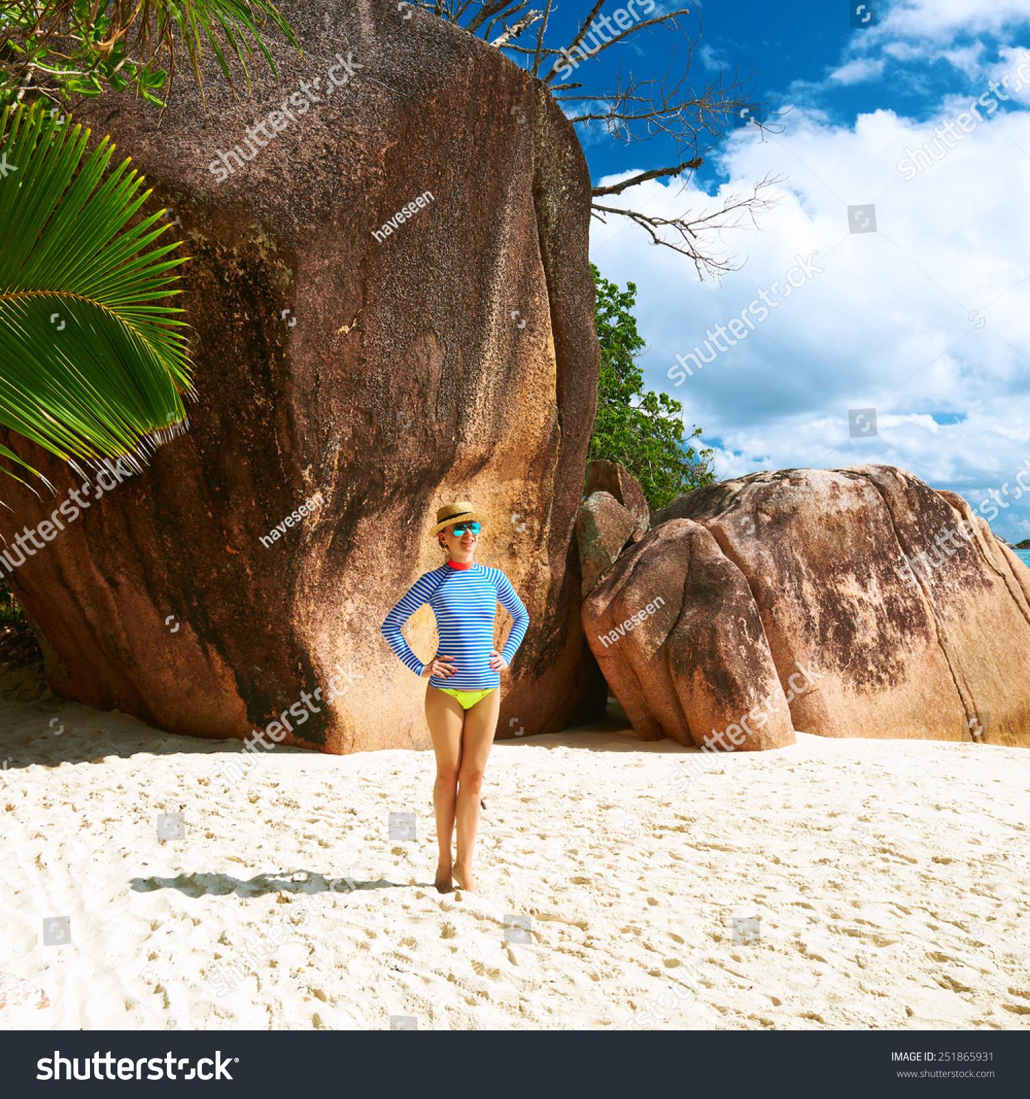 Seychelles Beach: Woman At Beautiful Beach Wearing Rash Guard. Seychelles