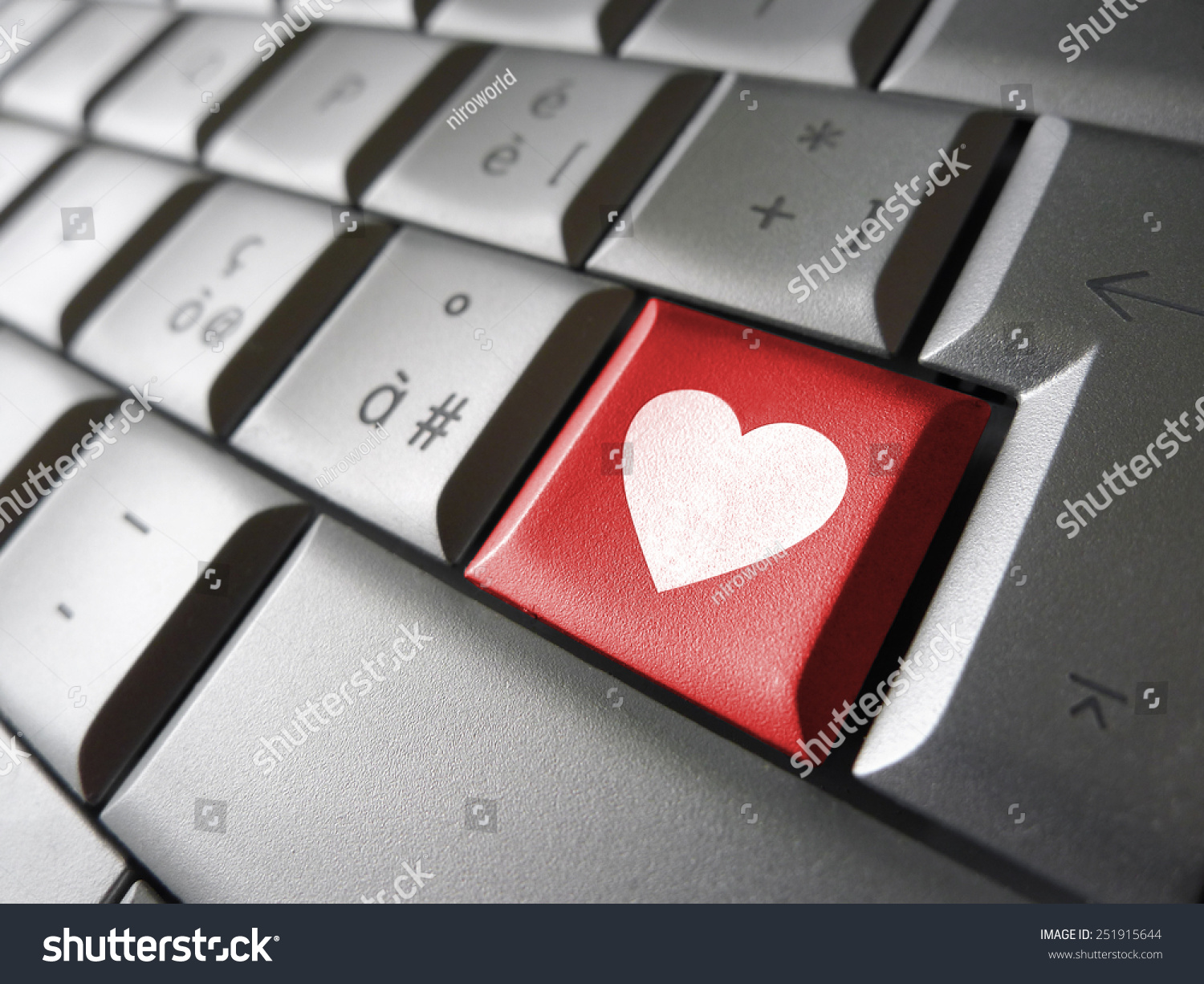Online love valentines lovers concept heart stock photo 251915644 online love and valentines lovers concept with a heart icon and symbol on a red computer buycottarizona Choice Image
