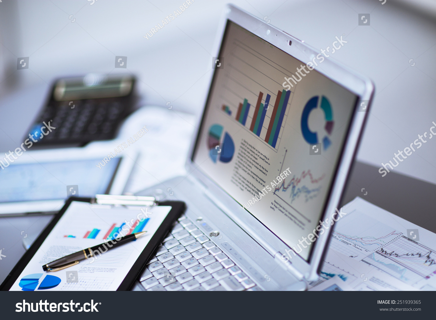 Businessman analyzing investment charts with laptop Accounting