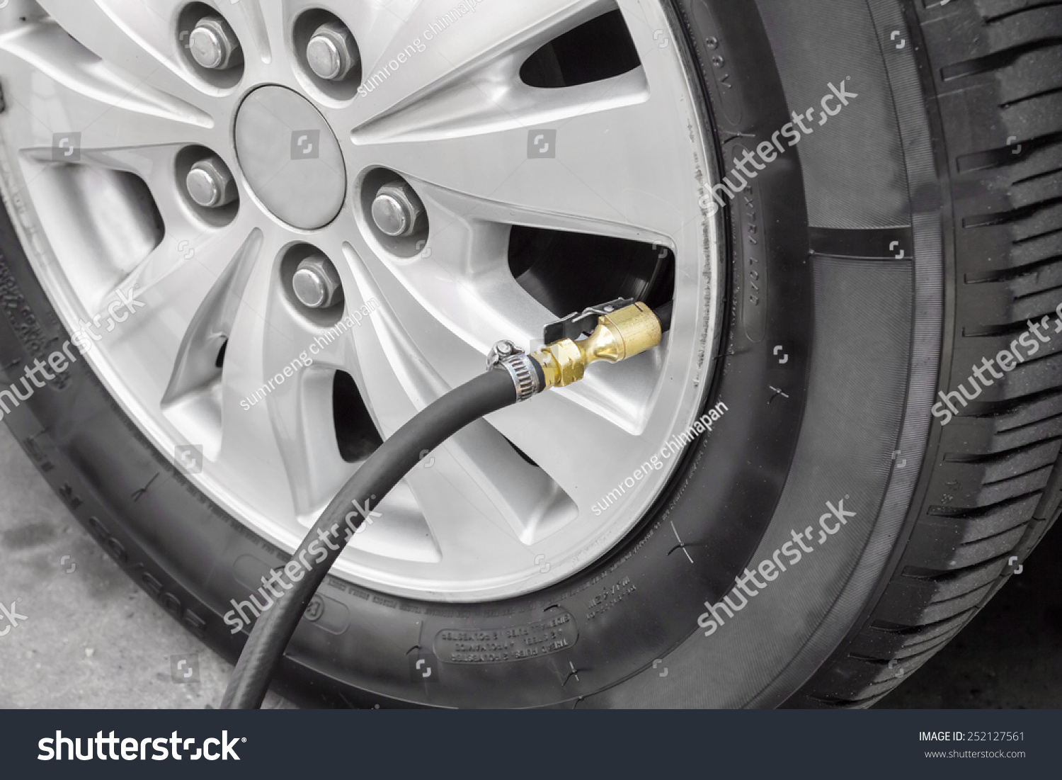 filling air into a car tire stock photo 252127561 shutterstock. Black Bedroom Furniture Sets. Home Design Ideas