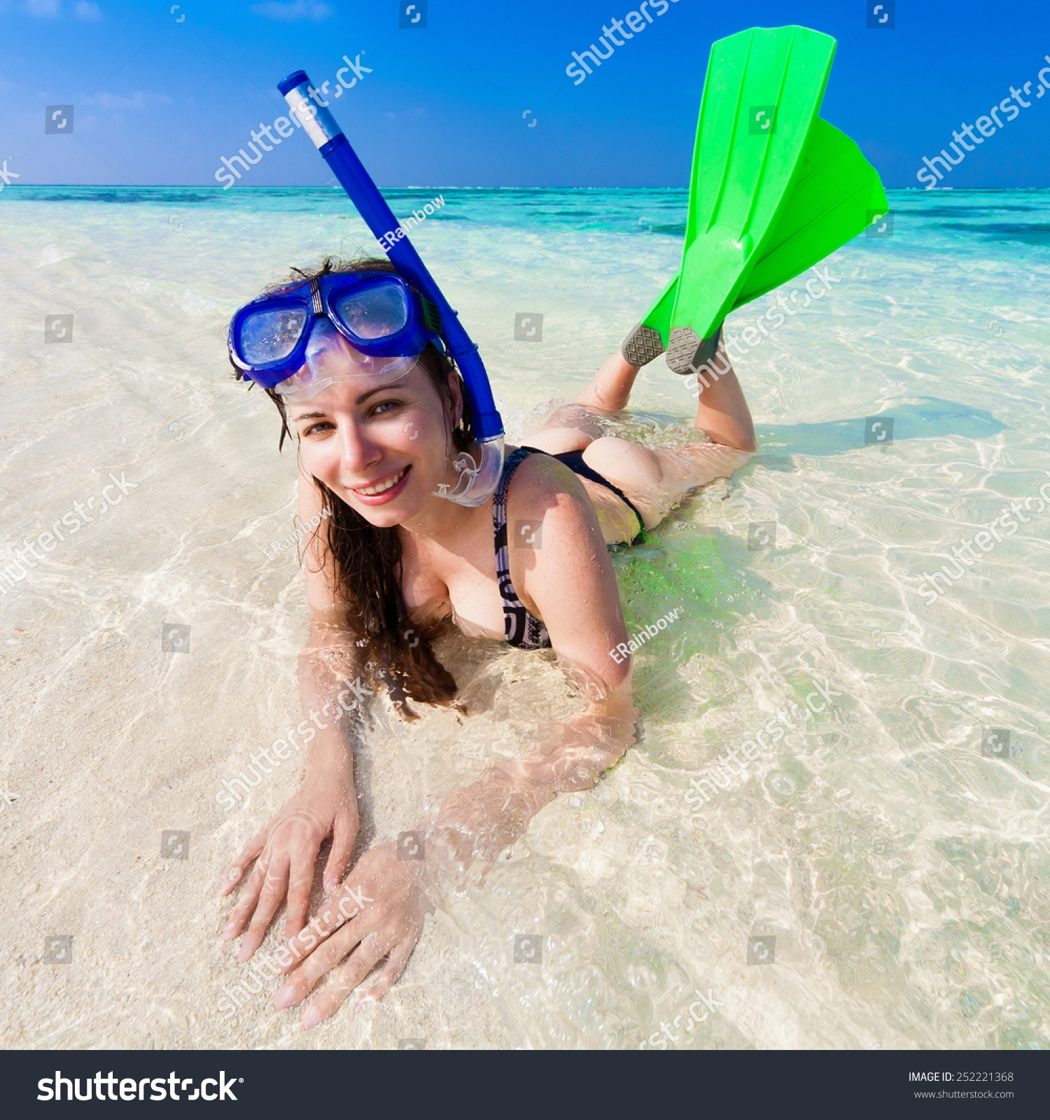 beautiful fun smiling sexy young women with flippers, mask and tube  snorkeling in Maldives romantic