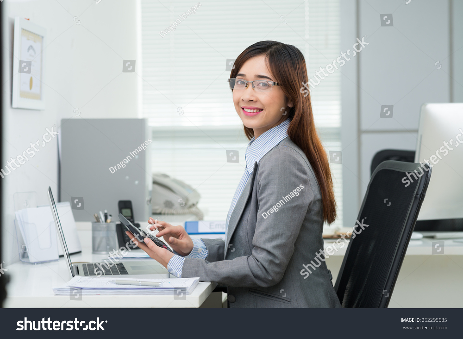 Portrait Of Vietnamese Female Accountant Working In The Office